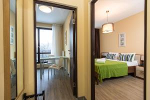 Кровать или кровати в номере SKYPARK Апартаменты