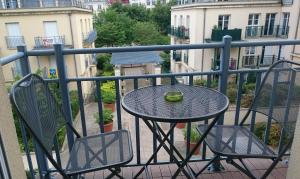 A balcony or terrace at Apartment in Chessy very near Disneyland