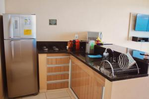 A cozinha ou cozinha compacta de Ocean Green Flats
