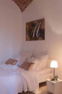 A bed or beds in a room at Arc Apartment