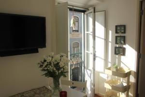 Televisor o centre d'entreteniment de Tasty Lisboa Flat - Alfama 2