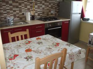 A kitchen or kitchenette at Anikó Apartman