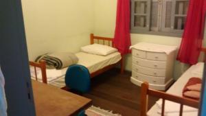 A bed or beds in a room at bahia norte e sul à seus pés