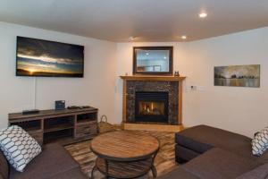 A television and/or entertainment center at Gilmore Lake 4 Home