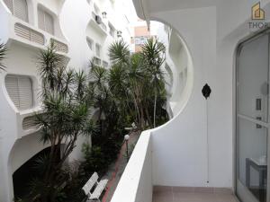 A balcony or terrace at Apartamento 3 dorms para 7 pessoas Guarujá- Praia da Enseada