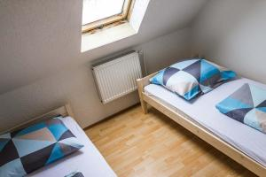 A bed or beds in a room at Chalupa Horní Podluží