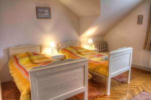 A bed or beds in a room at Maison Maryla