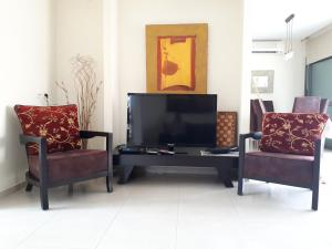 A television and/or entertainment center at Marina Cottage Apartment