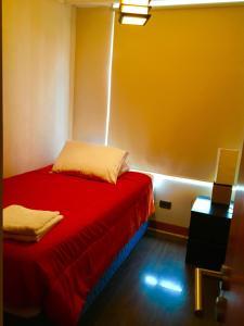 Cama o camas de una habitación en Crossurapart Padre Mariano