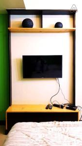 A television and/or entertainment center at Centrio Towers - Studio Type (#1)