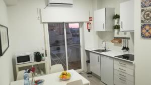Kitchen o kitchenette sa Porto Center Apart