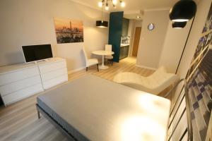 Cama ou camas em um quarto em Towarowa Residence