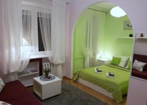 A bed or beds in a room at A.G - Apartamenty Warsaw Center