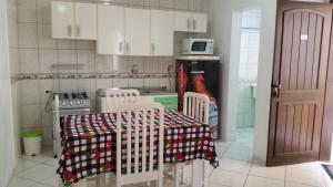 A kitchen or kitchenette at Residencial Marítimos