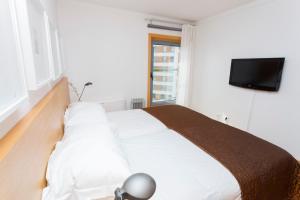 En eller flere senge i et værelse på Apartments Lisboa - Parque das Nacoes