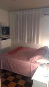 Cama o camas de una habitación en Casa praia da cachoeira
