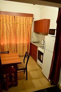 Una cocina o kitchenette en Departamentos Camilo