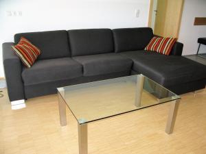 Ein Sitzbereich in der Unterkunft Apartments Max