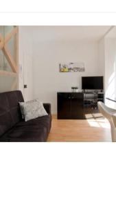 A seating area at Apartment Beco das Farinhas