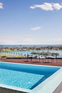 The swimming pool at or near Tyrian Albert Park Lake