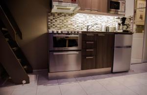Кухня или мини-кухня в Apartment Levi Star 1204