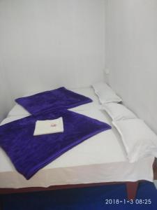 Cama o camas de una habitación en Sunleo Spice Villas & Homestay
