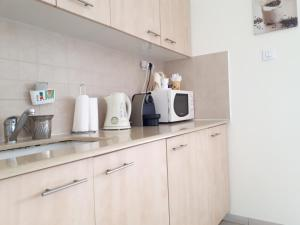 A kitchen or kitchenette at Keren's Sea View Apartment