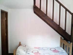 Una cama o camas en una habitación de Sol y Sombra