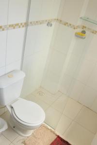 Um banheiro em Cobertura Relax beach