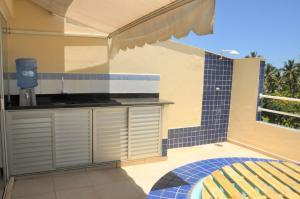 A cozinha ou cozinha compacta de Cobertura Relax beach
