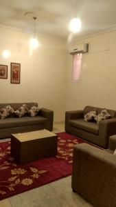 אזור ישיבה ב-Qasr Dalin Furnished Apartments