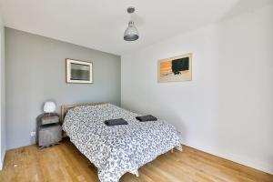 A bed or beds in a room at Les Terrasses De Chaumont 1