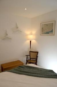 A bed or beds in a room at Proa d'Alfama Guest House