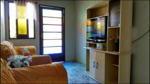 A television and/or entertainment center at Irma Sonia