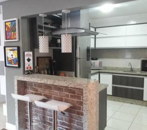 A kitchen or kitchenette at Melhor Localização em Foz