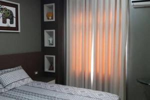 A bed or beds in a room at Melhor Localização em Foz