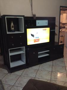 A television and/or entertainment center at Casa nego
