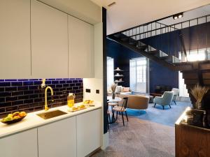 A cozinha ou kitchenette de Apartamentos The Arc Carrís