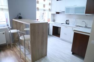 A kitchen or kitchenette at Apartment in the city center