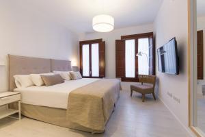 Ein Bett oder Betten in einem Zimmer der Unterkunft Shine Alcaiceria