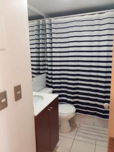 Un baño de Central Apartment Santiago BYP