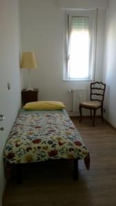 A bed or beds in a room at Gim House
