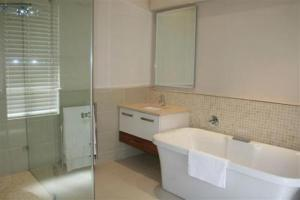 A bathroom at Marine Square Luxury Holiday Suites