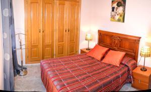 Cama o camas de una habitación en Apartamentos Sevilla