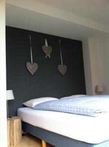 Ein Bett oder Betten in einem Zimmer der Unterkunft Huis Sandevoerde