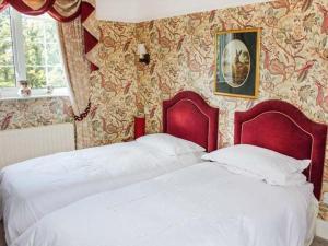 Giường trong phòng chung tại White Oak Grange