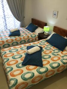 A bed or beds in a room at Your Home Baguio