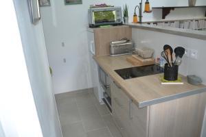 Cuisine ou kitchenette dans l'établissement Les Herbagettes