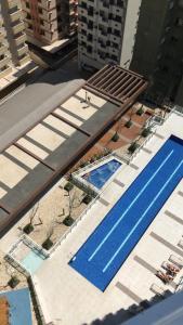 Uma vista da piscina em Unlimited Apartamento1309 ou nas proximidades