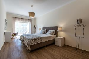 A bed or beds in a room at Marina Garden Albufeira